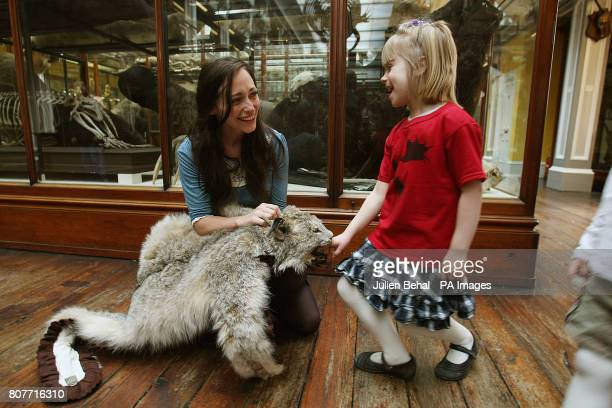Natural History Museum employee Mary Jane Fitzsimmons with the remains of a Lynx cat entertains a young visitor after Minister for Social and Family...