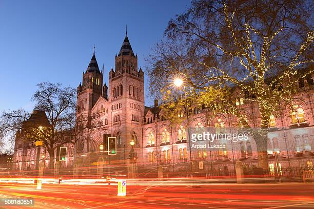 Natural History Museum in South Kensington; London, captured in Winter time with some of the trees in front decorated with Christmas lights.