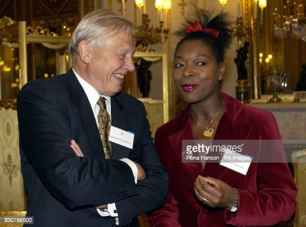 Natural History TV presenter Sir David Attenborough shares a joke with children's TV presenter Floella Benjamin at a reception for the British...