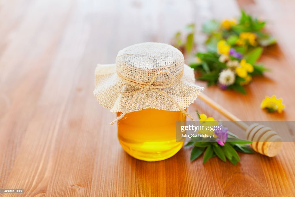 Natural honey with flowers : Stockfoto