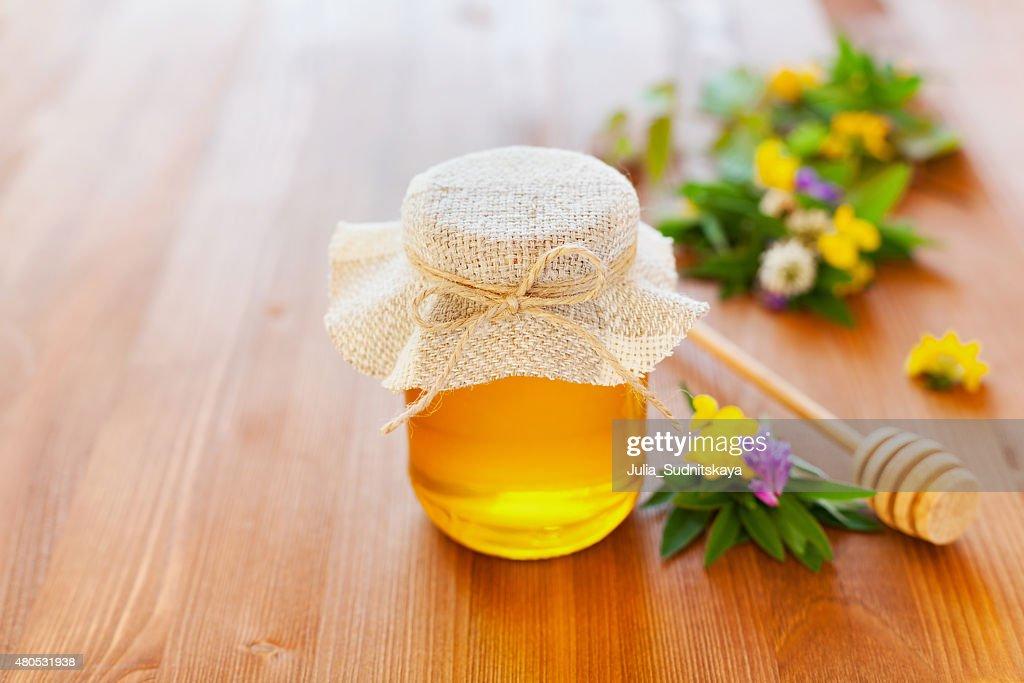 Miele con fiori naturali : Foto stock