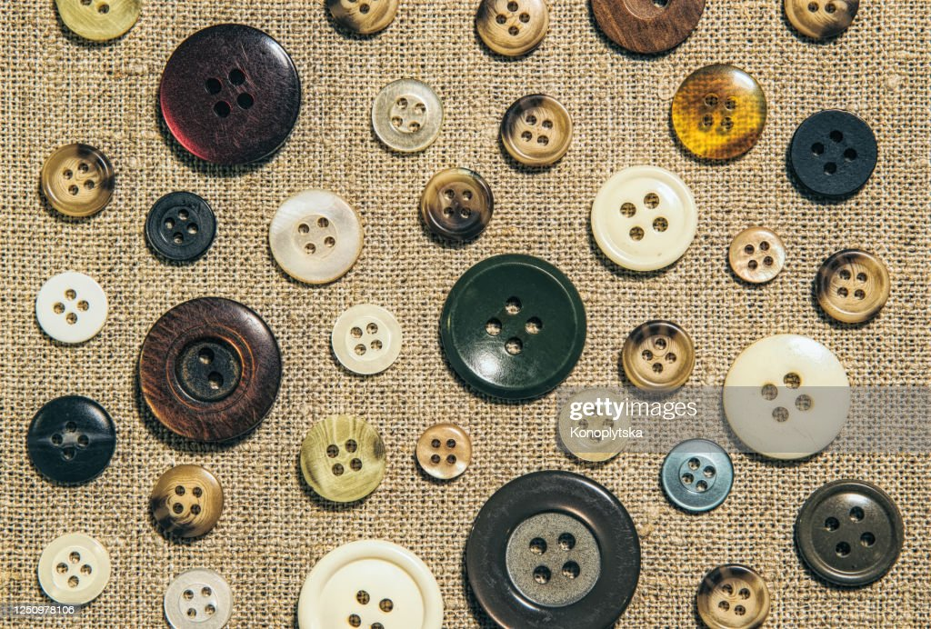 Natural linen fabric and elegant brown old-fashioned buttons : Stock Photo