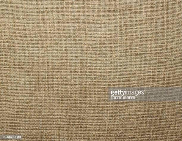 natural linen raw uncolored textured sacking burlap background. hessian sack canvas woven texture. - 繊維 大麻 ストックフォトと画像