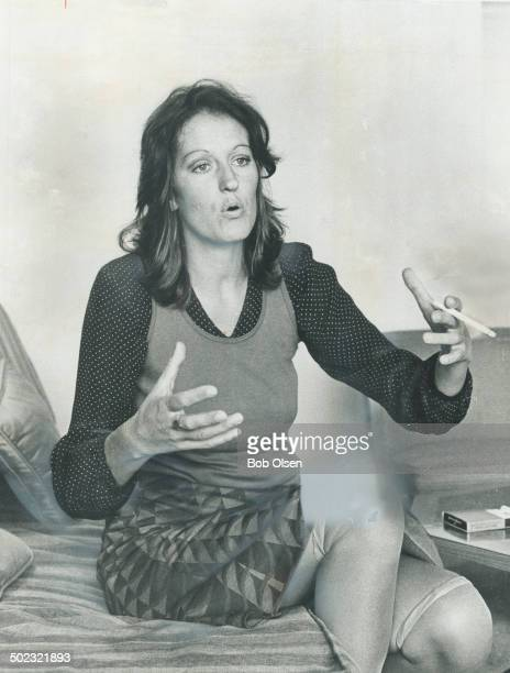Natural look to Germaine Greer means rumpled hair no makup a purple midilength skirt and orange stockings rolled to the knees She says I'm sick of...