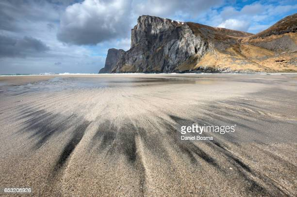 Natural patterns and contrasts on stunningly beautiful beach on Lofoten islands in Norway