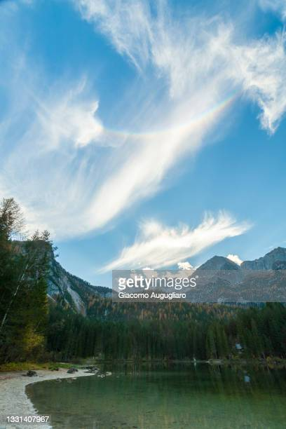 natural phenomenon in the sky above tovel lake, ville d'anaunia, trento province, trentino-alto adige, italy - light natural phenomenon stock pictures, royalty-free photos & images
