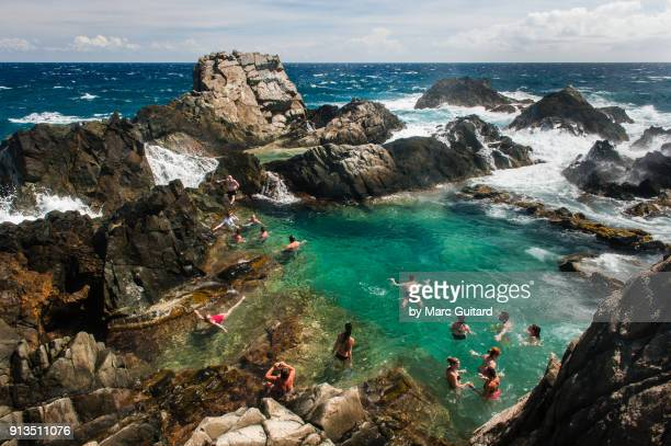 natural pool in arikok national park on the north coast of aruba - lagoon stock pictures, royalty-free photos & images