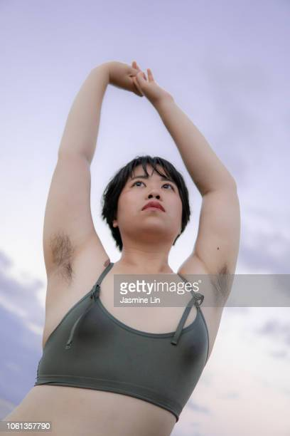 natural portrait of woman with armpit hair - armpit hair woman stock pictures, royalty-free photos & images