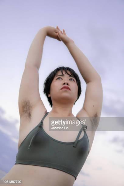 natural portrait of woman with armpit hair - estrias fotografías e imágenes de stock