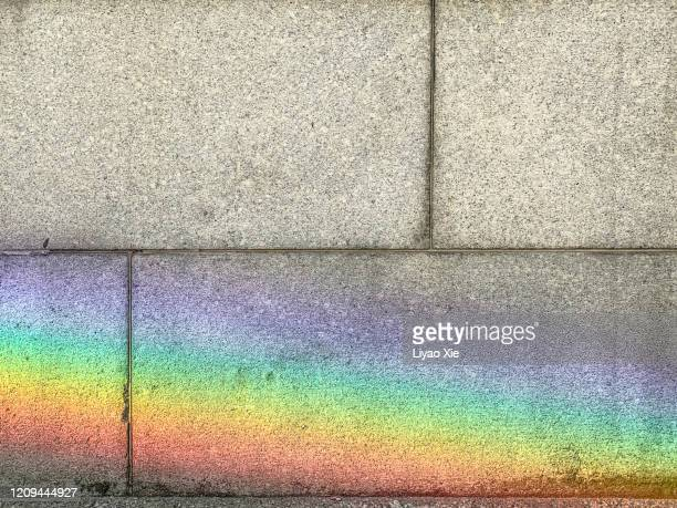 natural rainbow on the wall - liyao xie stock pictures, royalty-free photos & images