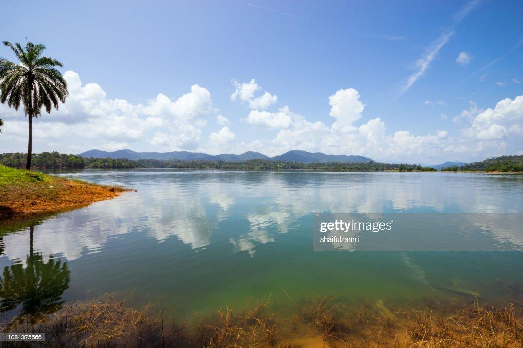 Natural reflection at lake Kenyir of Terengganu, Malaysia. : Stock Photo