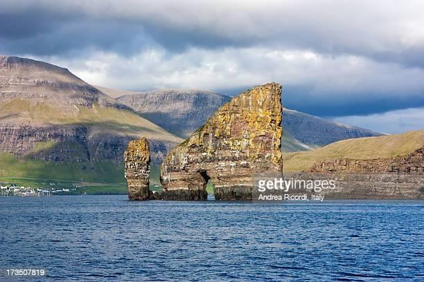 Natural rock arch through a sea stack