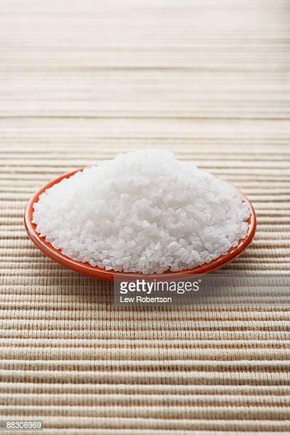 Natural rock salt on plate