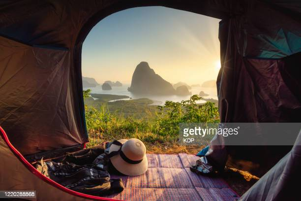 natural scenic view of seascape with archipelago against sky seen through camping tent. nature landscape mangrove forest of rainforest at phang nga bay, thailand. outdoors leisure activities and adventure camping. - tranquil scene stock pictures, royalty-free photos & images