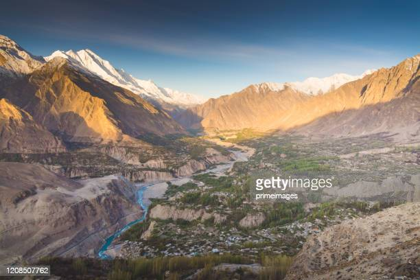 natural view along karakorum mountains at hunza valley with cherry blossom autumn season pakistan - islamabad stock pictures, royalty-free photos & images