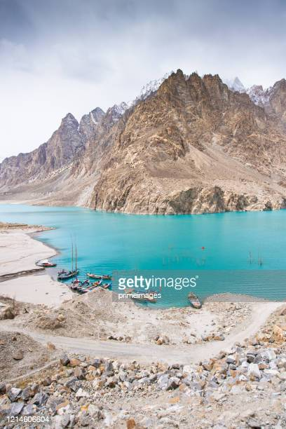 natural view along karakorum mountains attabad lake at hunza valley with cherry blossom autumn season pakistan - islamabad stock pictures, royalty-free photos & images