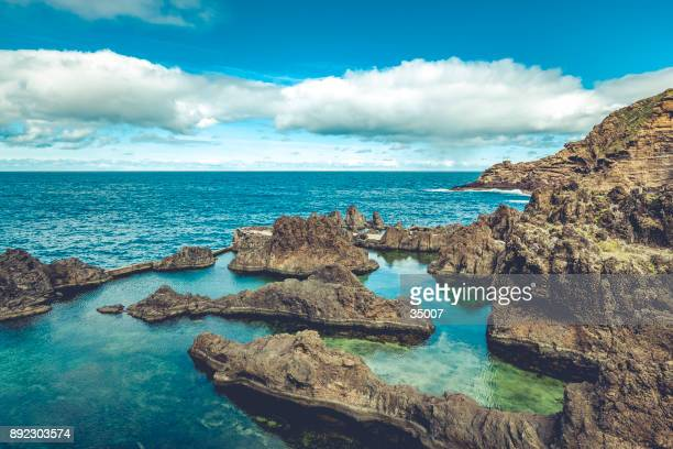 natural volcanic pools in porto moniz, madeira island, portugal - lareira stock pictures, royalty-free photos & images