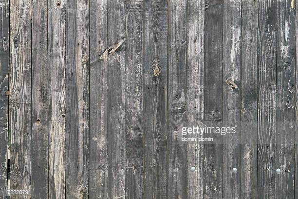 Natural wooden background, fence made with wooden gray vertical planks