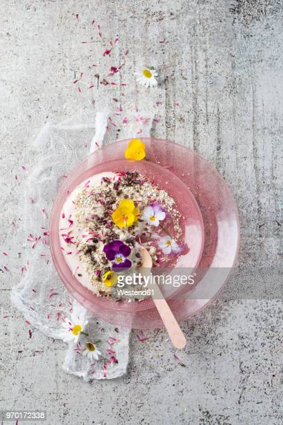 natural yoghurt with buckwheat grits, edible flowers and cacao nibs - buckwheat stock pictures, royalty-free photos & images
