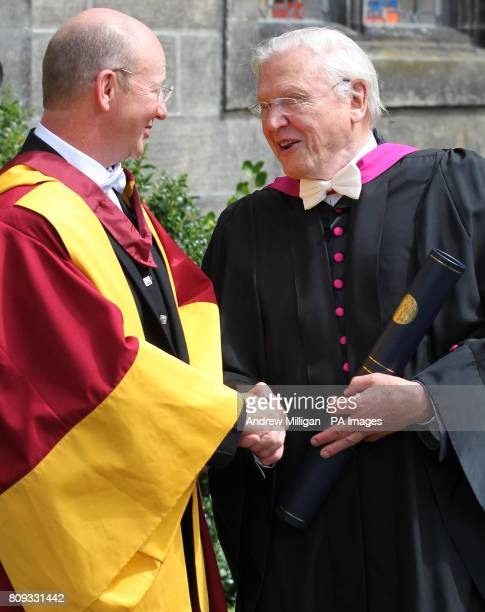 Naturalist and broadcaster Sir David Attenborough shakes hands with professor David Paterson after receiving an honorary degree from the University...
