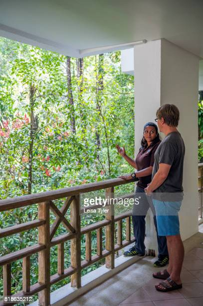 Naturalist Shakira Mobarak pointing to a colugo or flying lemur to a guest at the Andaman a Luxury Collection Resort on Datai Bay on the Malaysian...