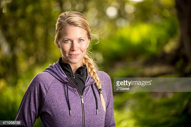 naturally beautiful young woman on a forest trail - purple shirt stock photos and pictures