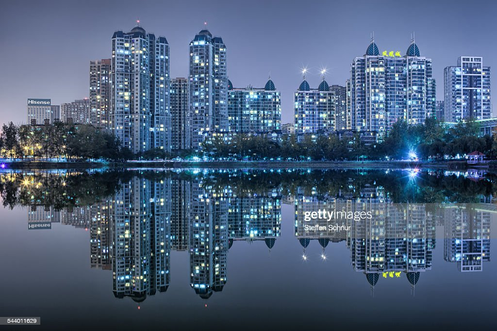 Nature and city mirrored skyline at sea China : Stock Photo