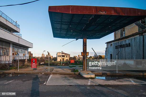 Nature covers an abandoned gas station in the Varosha quarter on January 5, 2017 in Famagusta, Cyprus. Prior to the Turkish invasion of Cyprus in...