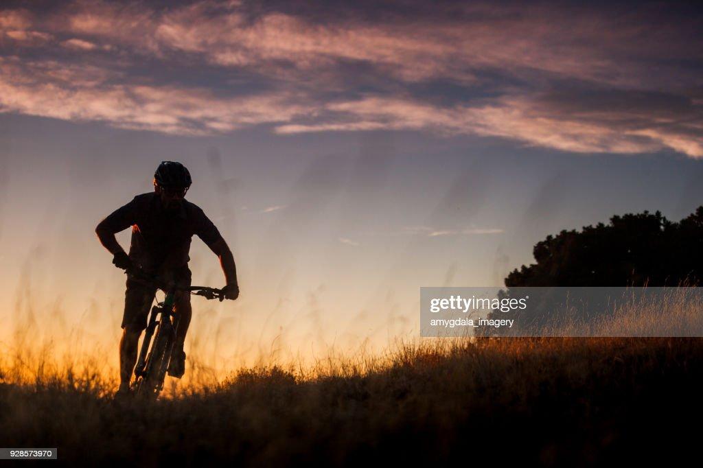 nature inspiration man mountain biking : Stock Photo