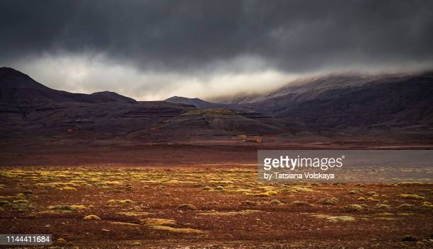 nature panorama with storm weather in fantastic mountains, morocco, africa - 人里離れた ストックフォトと画像