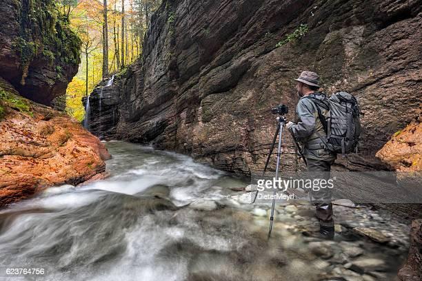 Nature photographer at alpine Stream - Taugl canyon
