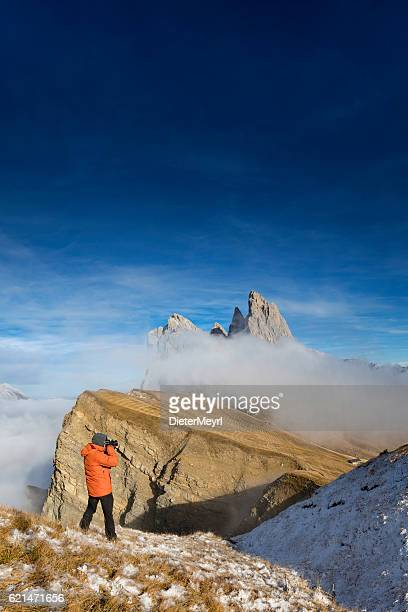 nature photographer at seceda, geisler group in southtirol, alps - dieter meyrl stock-fotos und bilder