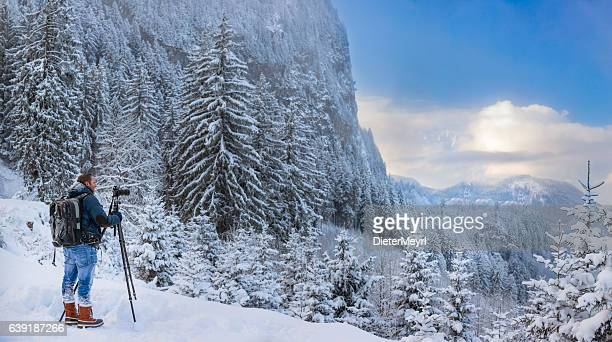 nature photographer at winter in front of hohenschwangau - dieter meyrl stock-fotos und bilder