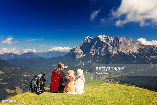 Nature photographer enjoy the view his dogs, Zugspitze, Alps