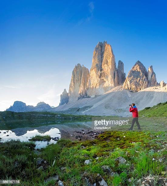 Nature photographer in the Dolomites at sunrise