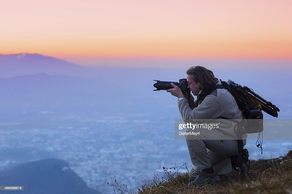 Nature photographer in the mountains  over salzburg : Stock Photo