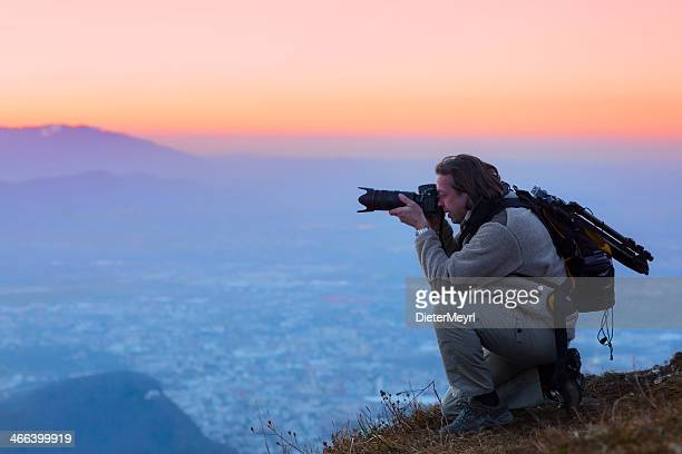 Nature photographer in the mountains  over salzburg