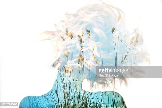 Nature view and woman's body - double exposure image