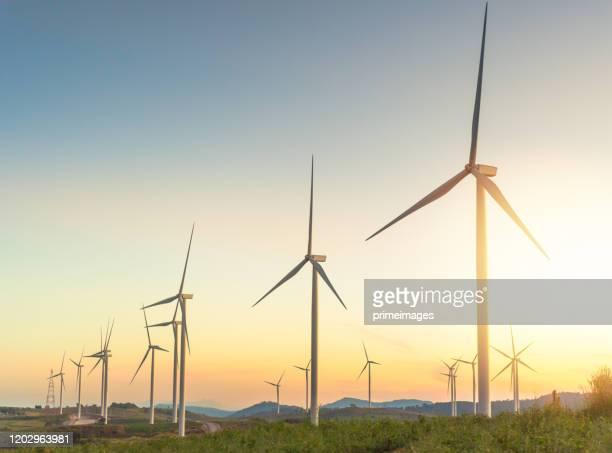 nature wind turbines and solar panels with high voltage electricity power line for clean energy in mountains - mill stock pictures, royalty-free photos & images