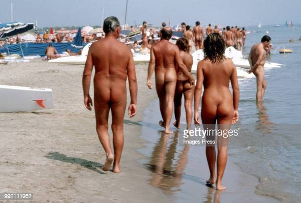 Naturists walk on a beach in Cap D'Agde circa 1980 in Agde France