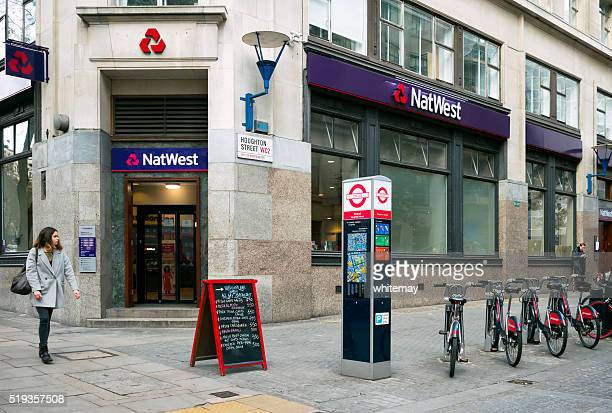 NatWest Bank and Santander bikes in Houghton Street, London