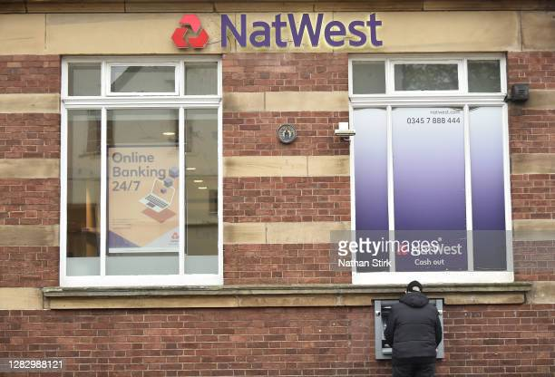 NatWest Bank atm on October 30, 2020 in Newcastle-under-Lyme, England. HSBC Chief Executive Noel Quinn said the bank will review pricing strategy for...