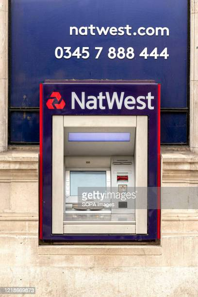 NatWest Bank cash machine seen outside one of their branches.