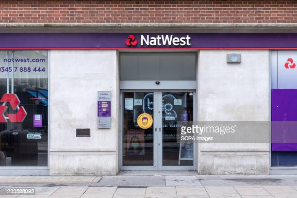 NatWest bank logo is seen at one of their branches on Dean Street in London.