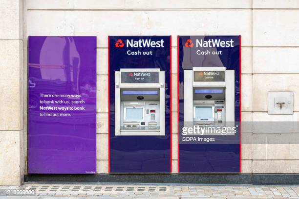 NatWest cash machines seen outside one of their branches.