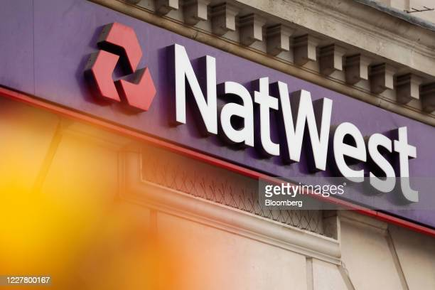 NatWest logo sits on a NatWest Group Plc bank branch in London, U.K., on Monday, July 27, 2020. The Treasury is in talks with the U.K.'s largest...