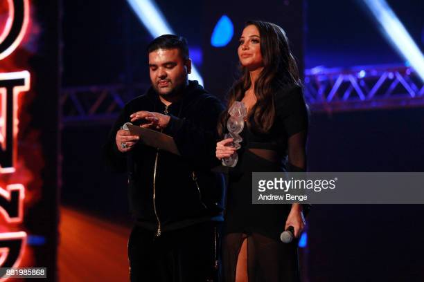 Naughty Boy and Tulisa Contostavlos on stage at the MOBO Awards at First Direct Arena Leeds on November 29 2017 in Leeds England
