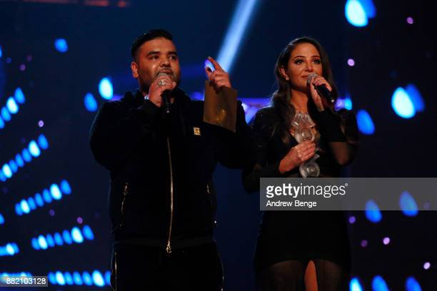 Naughty Boy and Tulisa Contostavlos speak on stage at the MOBO Awards at First Direct Arena Leeds on November 29 2017 in Leeds England