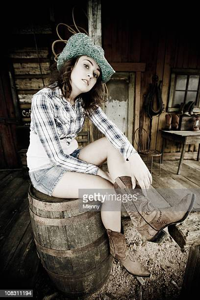 naughty cowgirl - legs and short skirt sitting down stock pictures, royalty-free photos & images