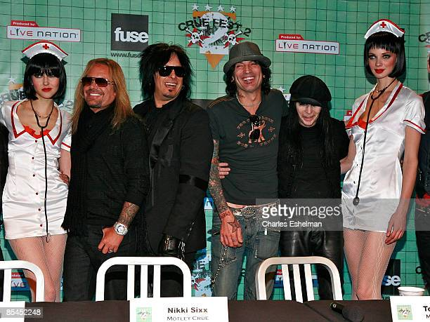 Naughty nurse The hard rock band Motley Crue' Vince Neil Nikki Sixx Tommy Lee and Mick Mars and another naughty nurse attend a press conference to...